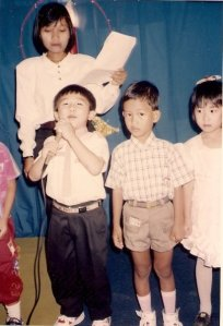Me is the one who hold the mic. Right behind me is Ibu Muji, my kindergarten teacher. The one who introduced me words, so I can write and read like now.